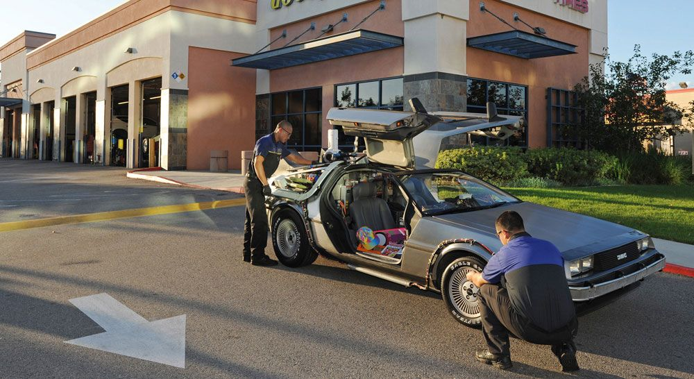 October 20, 2015 Lakewood, CA - A replica DeLorean time machine makes a pit stop at a local Godyear dealer for a full checkup before its big day. Goodyear Eagle tires were used on the original car in the Back to the Future trilogy, which famously travelled forward in time to October 21, 2015. (Carlos Delgado/AP Images for Goodyear)