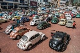 "TOPSHOT - VW Beetle cars are parked during the first event gathering owners of classic Volkswagen owners, in Addis Ababa, on December 21, 2019. - The event it's the first of its kind in Ethiopia where the classic VW Beetle model has been a part of the life of many Ethiopians. Nasredin Mohamed, one of the organisers said: ""We love our Volkswagens, so it's out of passion that we organised this event."" ""The car is beautiful, curvy, photogenic, easy to maintain."" But he noted that parts for the car are expensive, creating ""high maintenance costs"", so ""young people are ditching it. We need to inspire the youth to love the car once again."" The event also gathered also owners of the classic VW van. (Photo by EDUARDO SOTERAS / AFP)"
